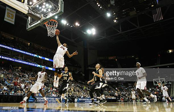 Michael Qualls of the Arkansas Razorbacks dunks the ball against the Wofford Terriers during the second round of the 2015 NCAA Men's Basketball...