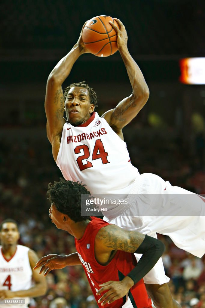Michael Qualls #24 of the Arkansas Razorbacks goes up for a rebound over the back of Elfrid Payton #2 of the Louisiana Ragin' Cajuns at Bud Walton Arena on November 15, 2013 in Fayetteville, Arkansas.