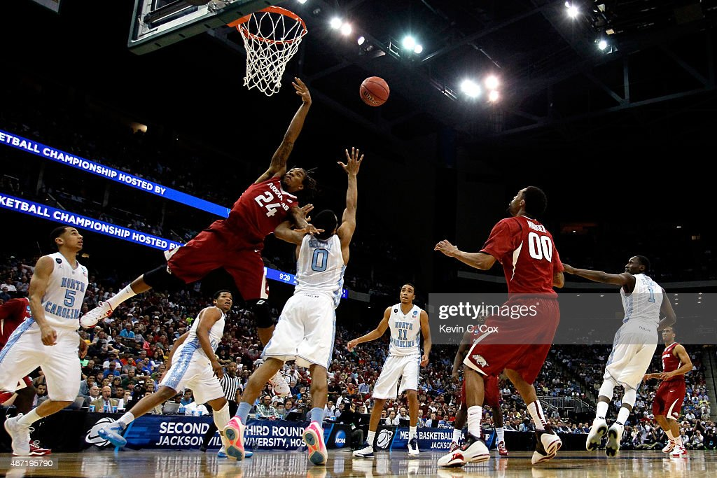 Michael Qualls of the Arkansas Razorbacks goes up for a rebound over Nate Britt of the North Carolina Tar Heels in the first half during the third...