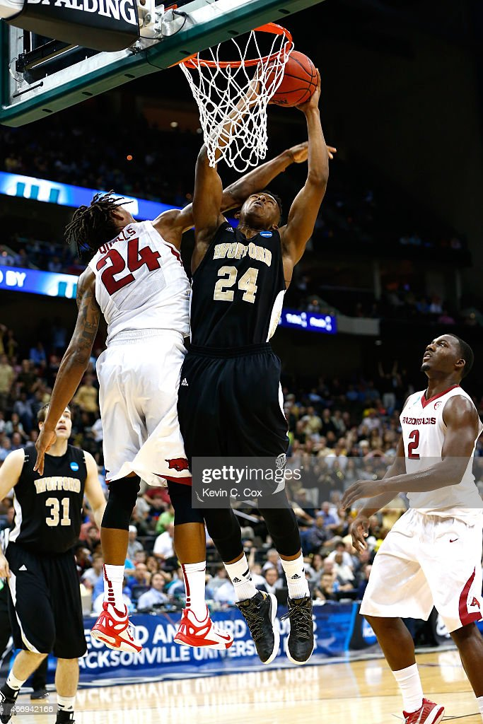Michael Qualls of the Arkansas Razorbacks tries to stop Justin Gordon of the Wofford Terriers during the second round of the 2015 NCAA Men's...