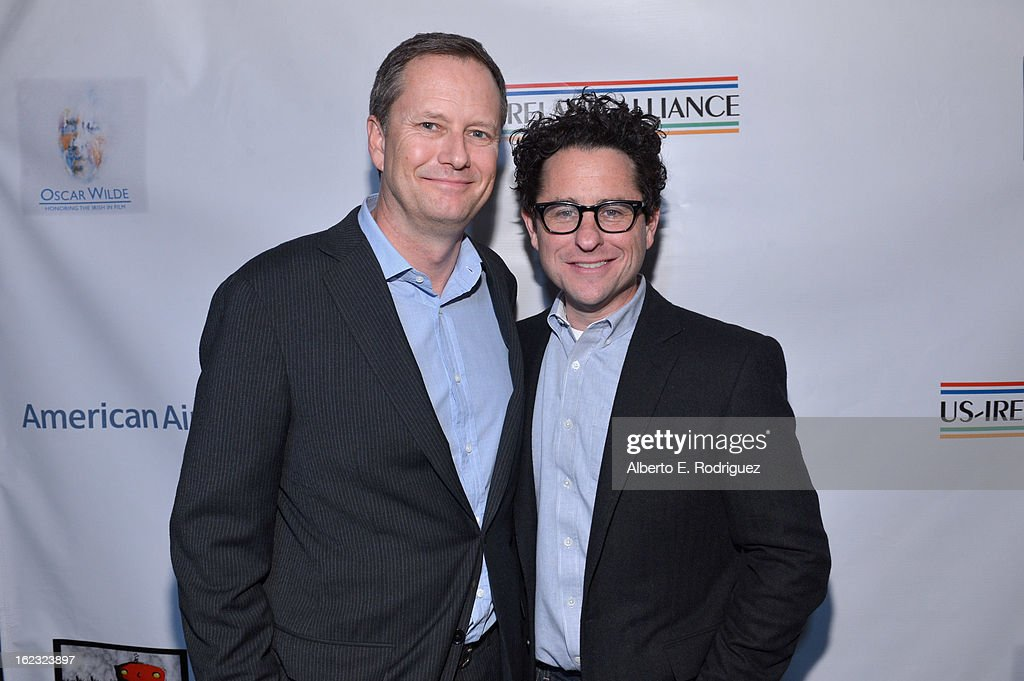 Michael R. Burns, Vice Chairman of Lions Gate Entertainment's Board of Directors and producer <a gi-track='captionPersonalityLinkClicked' href=/galleries/search?phrase=J.J.+Abrams&family=editorial&specificpeople=253632 ng-click='$event.stopPropagation()'>J.J. Abrams</a> attend the 8th Annual 'Oscar Wilde: Honoring The Irish In Film' Pre-Academy Awards Event at Bad Robot on February 21, 2013 in Santa Monica, California.