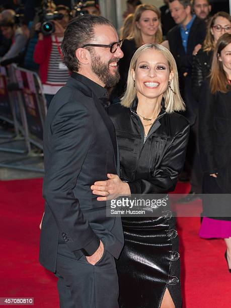 Michael R Roskam and Noomi Rapace attend a screening of 'The Drop' during the 58th BFI London Film Festival at Odeon West End on October 11 2014 in...