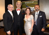 Michael R Yormark Andrea Bocelli Gloria Estefan and Frank G Russo backstage at BBT Center on February 14 2014 in Sunrise Florida