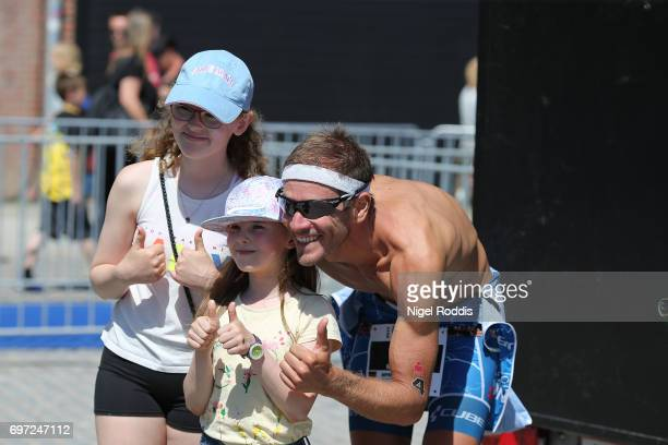 Michael Raelert of Germany poses for a picture with fans at the KMD IRONMAN 703 European Championship Elsinore on June 18 2017 in Helsingor Denmark