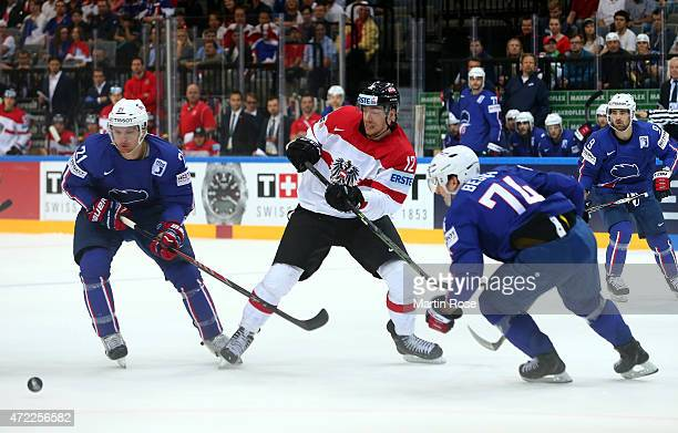 Michael Raffl of Austria and Antoine Roussel of France battle for the puck during the IIHF World Championship group A match between Austria and...
