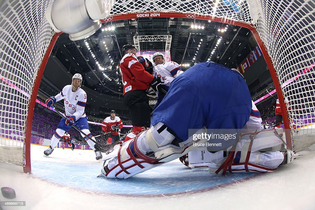 Michael Raffl #12 of Austria scores a goal in the first period against Lars Haugen #30 of Norway during the Men's Ice Hockey Preliminary Round Group B game on day nine of the Sochi 2014 Winter Olympics at Bolshoy Ice Dome on February 16, 2014 in Sochi, Russia.