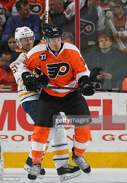 Michael Raffl of the Philadelphia Flyers battles against Andre Benoit of the Buffalo Sabres on February 19 2015 at the Wells Fargo Center in...