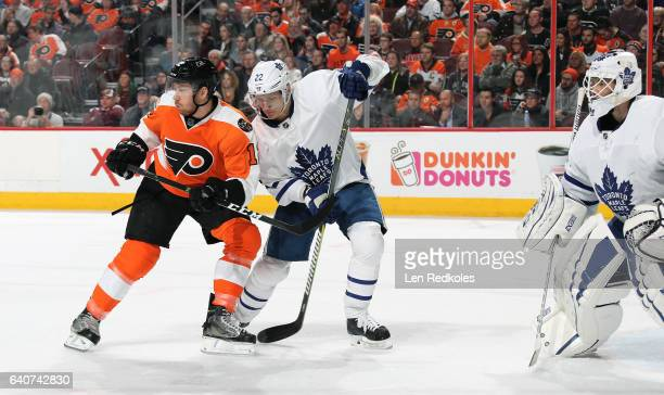 Michael Raffl of the Philadelphia Flyers battles for position in front of the net against Nikita Zaitsev and Curtis McElhinney of the Toronto Maple...