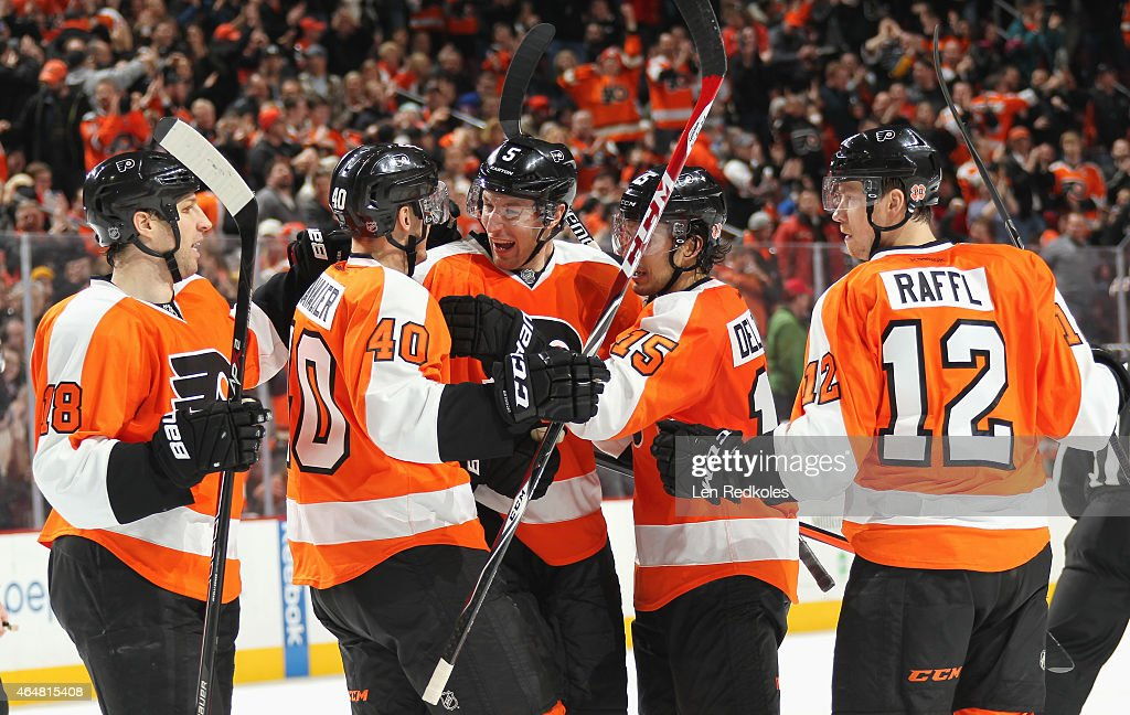 Michael Raffl of the Philadelphia Flyers celebrates his second period goal against the New York Rangers with teammates RJ Umberger Vincent Lecavalier...