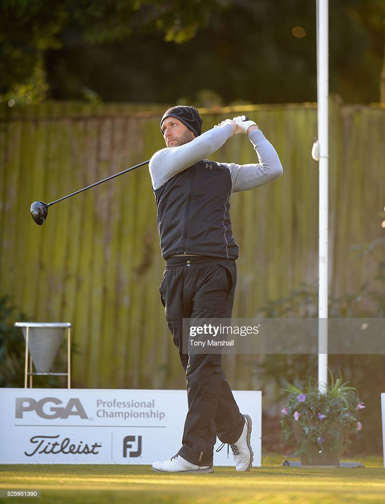 Michael Raj of Whittington Heath Golf Club plays his first shot on the 1st tee during the PGA Professional Championship - Midland Qualifier at Little Aston Golf Club on April 29, 2016 in Sutton Coldfield, England.