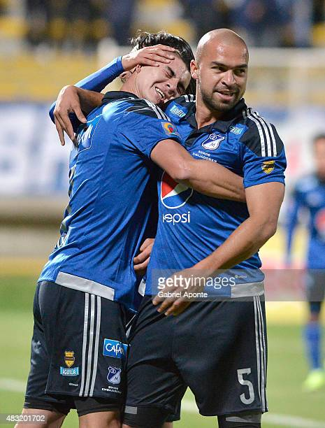 Michael Rangel of Millonarios celebrates with Andres Cadavid after scoring the second goal of his team during a match between Patriotas FC and...