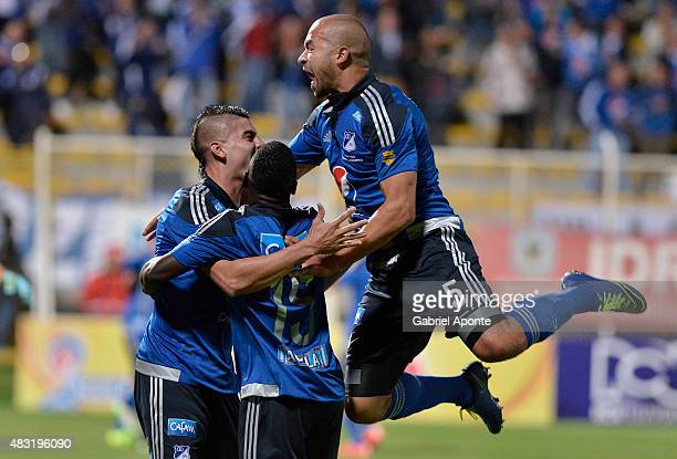 Michael Rangel of Millonarios celebrates with Andres Cadavid and Deiver Machado after scoring a goal during a match between Patriotas FC and...