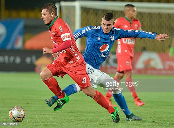 Michael Rangel of Millonarios fights for the ball with Leonardo Pico of Patriotas FC during a match between Millonarios and Patriotas FC as part of...