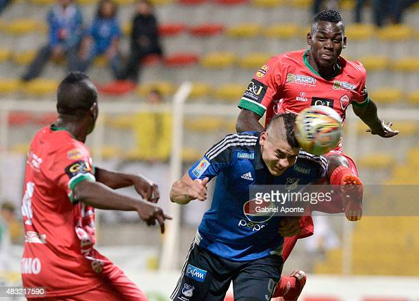 Michael Rangel of Millonarios struggles for the ball with Jonathan Segura and Jesus Murillo of Patriotas FC during a match between Patriotas FC and...