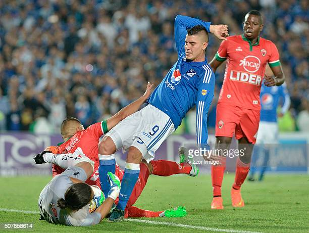Michael Rangel player of Millonarios fights for the ball with Juan Castillo goalkeeper of Patriotas FC during a match between Millonarios and...