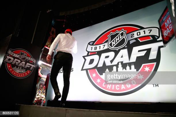 Michael Rasmussen ninth overall pick of the Detroit Red Wings makes his way to the stage during Round One of the 2017 NHL Draft at United Center on...