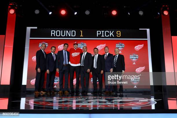 Michael Rasmussen poses for photos after being selected ninth overall by the Detroit Red Wings during the 2017 NHL Draft at the United Center on June...