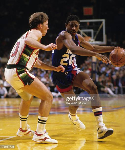 Michael Ray Richardson of the New Jersey Nets dribbling the ball as Mike Dunleavy of the Milwaukee Bucks defends during the 1984 NBA Playoffs in May...