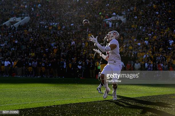 Michael Rector of the Stanford Cardinal catches a 33yard touchdown in the second quarter against the Iowa Hawkeyes in the 102nd Rose Bowl Game on...