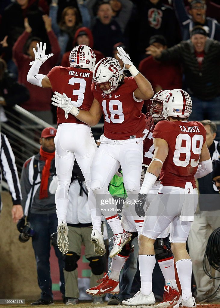 Michael Rector of the Stanford Cardinal is congratulated by Austin Hooper after he scored a touchdown against the Notre Dame Fighting Irish at...
