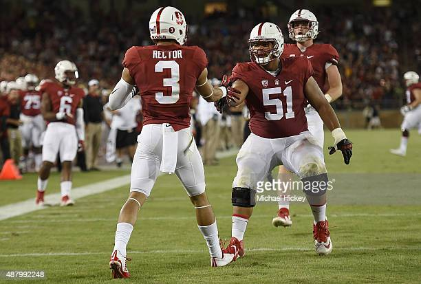 Michael Rector of the Stanford Cardinal is congratulated by Joshua Garnett after Rector caught a touchdown pass against UCF Knights in the second...