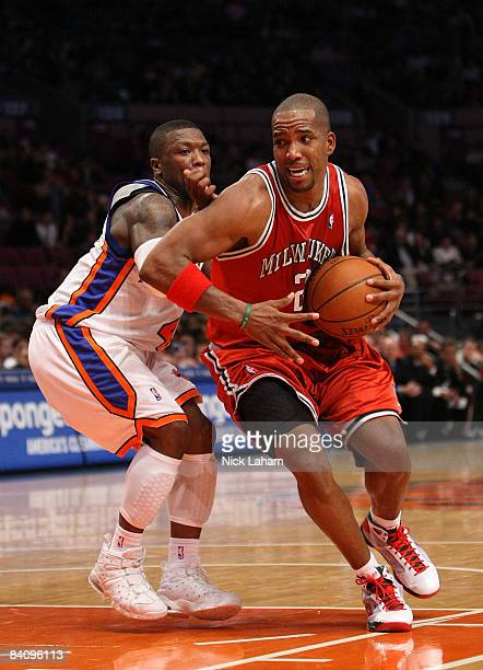 Michael Redd of the Milwaukee Bucks drives to the basket against Nate Robinson of the New York Knicks on December 19 2008 at Madison Square Garden in...