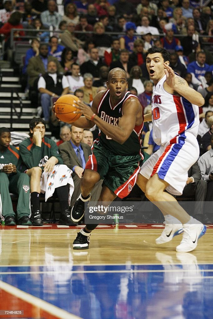Michael Redd #22 of the Milwaukee Bucks drives to the basket against Carlos Delfino #20 of the Detroit Pistons on November 1, 2006 at the Palace of Auburn Hills in Auburn Hills, Michigan. Milwaukee won the game 105-97.