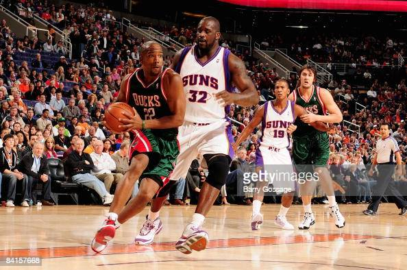 Michael Redd of the Milwaukee Bucks drives to the basket past Shaquille O'Neal of the Phoenix Suns during the game on December 9 2008 at US Airways...
