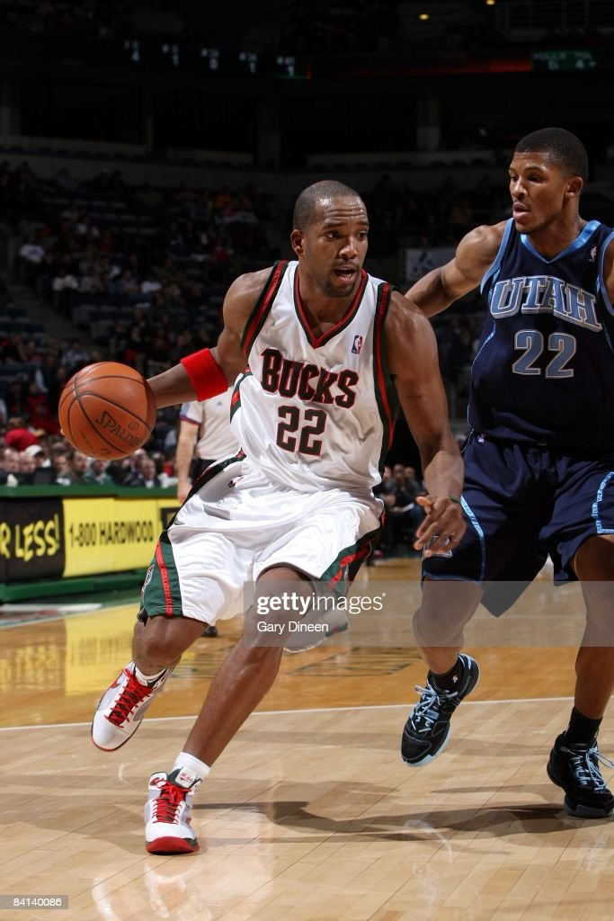 Michael Redd of the Milwaukee Bucks moves the ball against Morris Almond of the Utah Jazz during the game at the Bradley Center on December 23 2008...