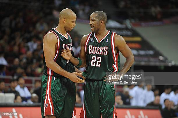 Michael Redd talks to teammate Richard Jefferson of the Milwaukee Bucks during the game against the Golden State Warriors at the Beijing Olympic...