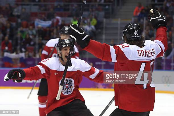 Michael Rene Grabner of Austria celebrates with his teammates after scoring a goal in the third period against Lars Haugen of Norway during the Men's...