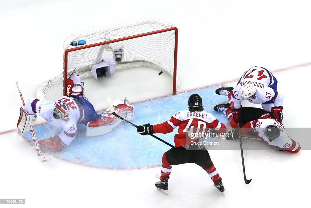 Michael Rene Grabner #40 of Austria scores a goal in the first period against <a gi-track='captionPersonalityLinkClicked' href=/galleries/search?phrase=Lars+Haugen&family=editorial&specificpeople=7718894 ng-click='$event.stopPropagation()'>Lars Haugen</a> #30 of Norway during the Men's Ice Hockey Preliminary Round Group B game on day nine of the Sochi 2014 Winter Olympics at Bolshoy Ice Dome on February 16, 2014 in Sochi, Russia.