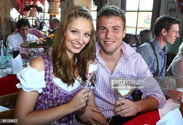 Michael Rensing goalkeeper of Bayern Muenchen and his girlfriend Saskia Treffkorn attend the Kaefer beer tent during the Oktoberfest beer festival on...