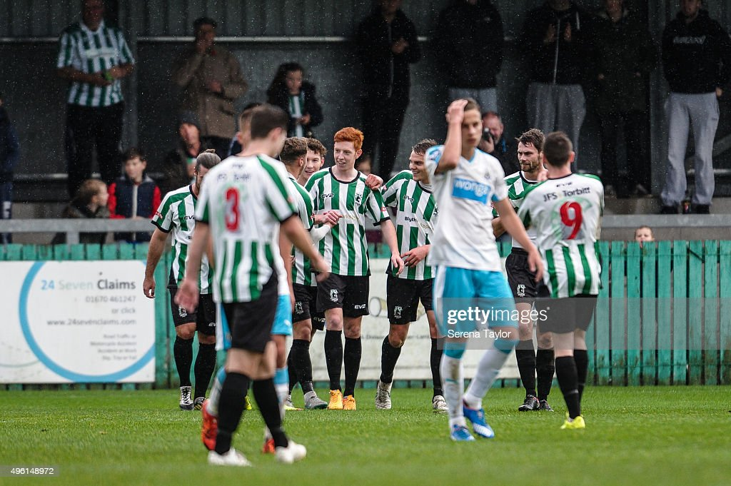 Michael Richardson of Blyth Spartans (C) celebrates with his teammates after scoring the opening goal during The Northumberland Senior Cup match between Blyth Spartans and Newcastle United at Croft Park on November 7, 2015, in Blyth, England.