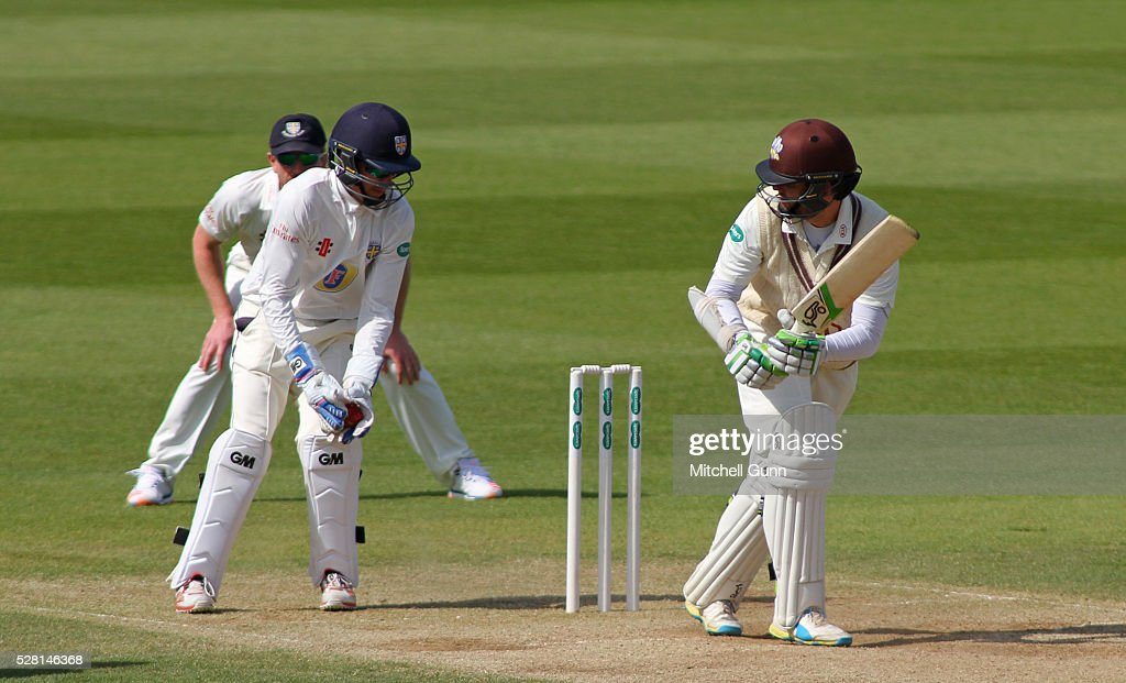 Michael Richardson of Durham catches the ball to dismiss Steven Davies of Surrey during the Specsavers County Championship Division One match between Surrey and Durham at the Kia Oval Cricket Ground, on May 04, 2016 in London, England.