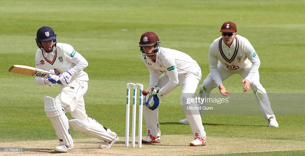 Michael Richardson of Durham plays a shot as wicketkeeper <a gi-track='captionPersonalityLinkClicked' href=/galleries/search?phrase=Ben+Foakes&family=editorial&specificpeople=7622687 ng-click='$event.stopPropagation()'>Ben Foakes</a> and fielder <a gi-track='captionPersonalityLinkClicked' href=/galleries/search?phrase=Jason+Roy+-+Cricket+Player&family=editorial&specificpeople=13892033 ng-click='$event.stopPropagation()'>Jason Roy</a> of Surrey look on during the Specsavers County Championship Division One match between Surrey and Durham at the Kia Oval Cricket Ground, on May 03, 2016 in London, England.