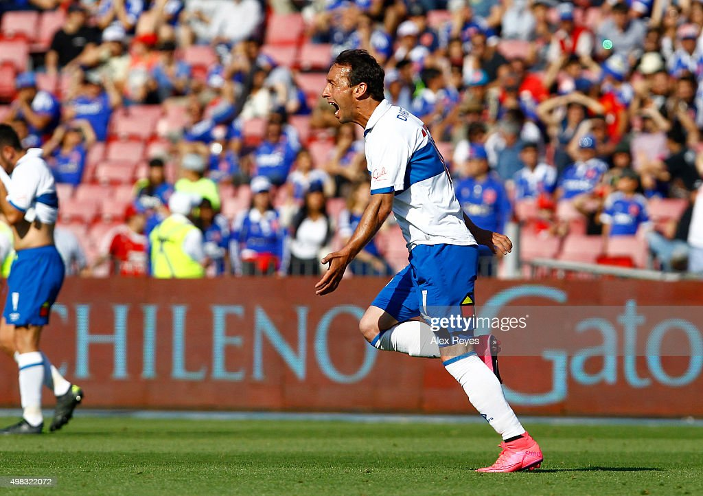 Michael Rios of Universidad Catolica celebrates after scoring the second goal of his team during a match between U de Chile and Universidad Catolica as part of 13th round of Campeonato Apertura 2015 at Nacional Stadium on November 22, 2015 in Santiago, Chile.