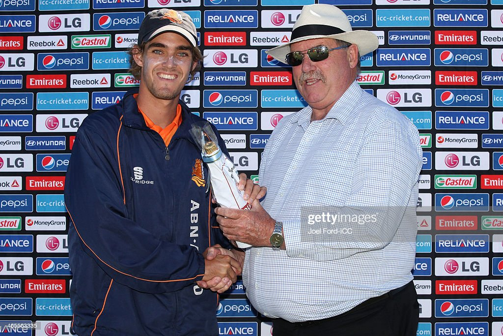 Michael Rippon of The Netherlands is awarded man of the match from Bay of Plenty Cricket Trust chairman Chris Rapson after an ICC World Cup qualifying playoff between The Netherlands and Canada on January 28, 2014 in Mount Maunganui, New Zealand.