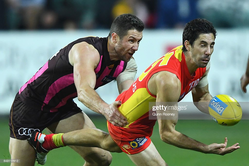 <a gi-track='captionPersonalityLinkClicked' href=/galleries/search?phrase=Michael+Rischitelli&family=editorial&specificpeople=574266 ng-click='$event.stopPropagation()'>Michael Rischitelli</a> of the Suns handballs whilst being tackled by James Frawley of the Hawks during the round 14 AFL match between the Hawthorn Hawks and the Gold Coast Suns at Aurora Stadium on June 26, 2016 in Launceston, Australia.