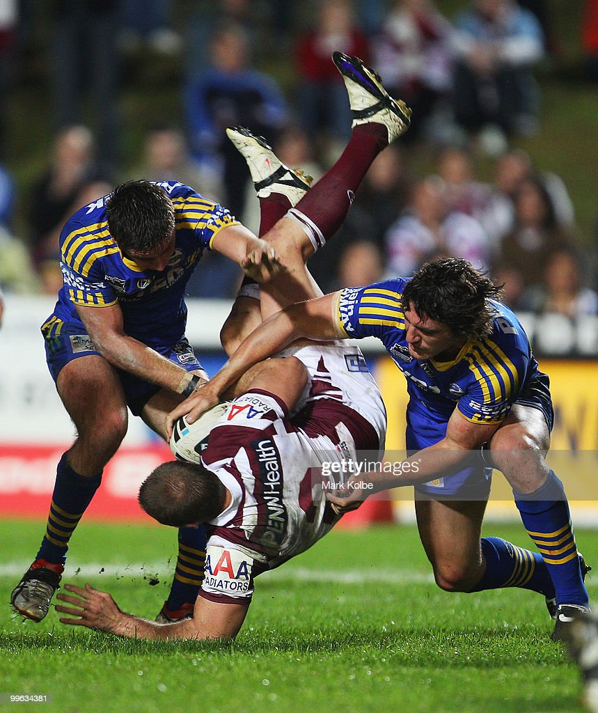 <a gi-track='captionPersonalityLinkClicked' href=/galleries/search?phrase=Michael+Robertson&family=editorial&specificpeople=234359 ng-click='$event.stopPropagation()'>Michael Robertson</a> of the Eagles is tackled during the round ten NRL match between the Manly Sea Eagles and the Parramatta Eels at Brookvale Oval on May 17, 2010 in Sydney, Australia.