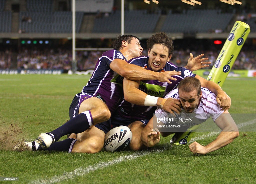 <a gi-track='captionPersonalityLinkClicked' href=/galleries/search?phrase=Michael+Robertson&family=editorial&specificpeople=234359 ng-click='$event.stopPropagation()'>Michael Robertson</a> of the Sea Eagles scores a try under pressure from <a gi-track='captionPersonalityLinkClicked' href=/galleries/search?phrase=Billy+Slater&family=editorial&specificpeople=171206 ng-click='$event.stopPropagation()'>Billy Slater</a> and <a gi-track='captionPersonalityLinkClicked' href=/galleries/search?phrase=Cooper+Cronk&family=editorial&specificpeople=234620 ng-click='$event.stopPropagation()'>Cooper Cronk</a> of the Storm during the round six NRL match between the Melbourne Storm and the Manly Sea Eagles at Etihad Stadium on April 19, 2010 in Melbourne, Australia.