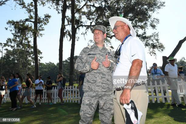 Michael Robichaud hugs his son SSGT James Robichaud at Patriots's Outpost during the first round of THE PLAYERS Championship on THE PLAYERS Stadium...