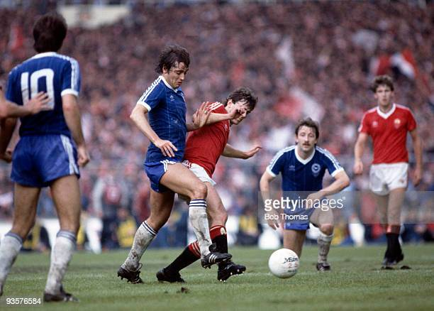 Michael Robinson of Brighton and Bryan Robson of Manchester United battle for possession during the FA Cup Final between Brighton and Manchester...