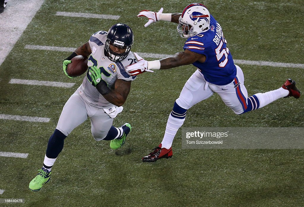 <a gi-track='captionPersonalityLinkClicked' href=/galleries/search?phrase=Michael+Robinson&family=editorial&specificpeople=228320 ng-click='$event.stopPropagation()'>Michael Robinson</a> #26 of the Seattle Seahawks carries the ball during an NFL game as <a gi-track='captionPersonalityLinkClicked' href=/galleries/search?phrase=Nigel+Bradham&family=editorial&specificpeople=6579576 ng-click='$event.stopPropagation()'>Nigel Bradham</a> #53 of the Buffalo Bills closes in for a tackle at Rogers Centre on December 16, 2012 in Toronto, Ontario, Canada.
