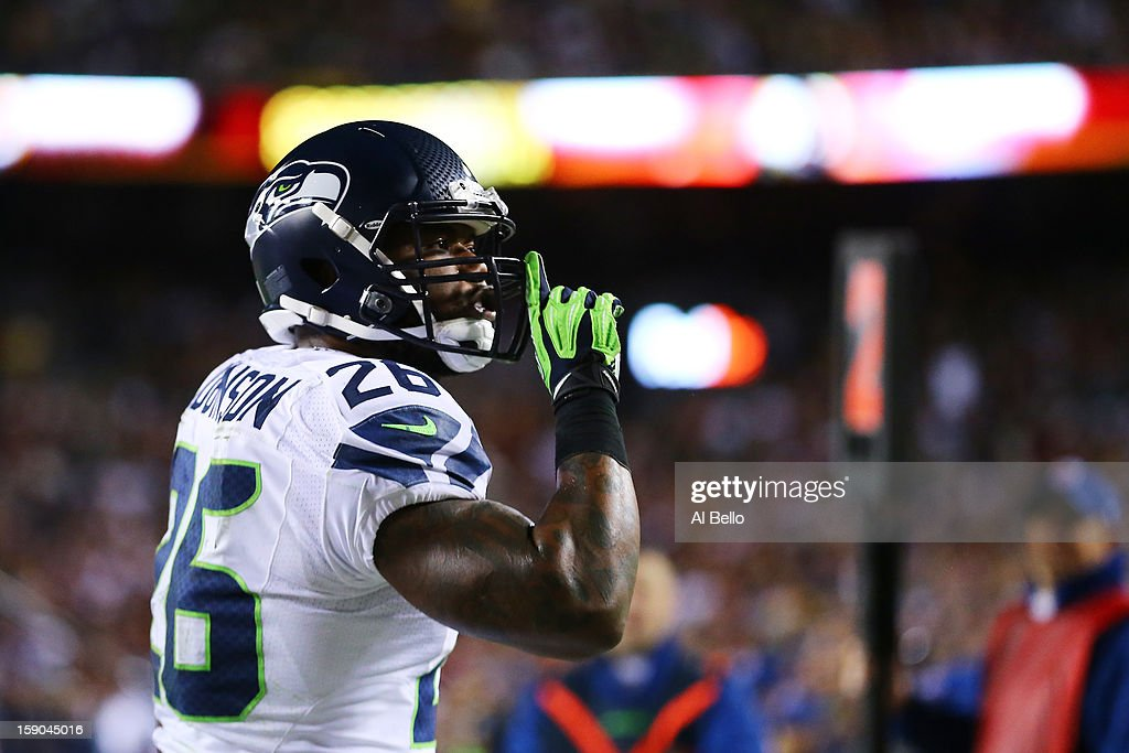 <a gi-track='captionPersonalityLinkClicked' href=/galleries/search?phrase=Michael+Robinson&family=editorial&specificpeople=228320 ng-click='$event.stopPropagation()'>Michael Robinson</a> #26 of the Seattle Seahawks celebrates his second quarter touchdown against the Washington Redskins during the NFC Wild Card Playoff Game at FedExField on January 6, 2013 in Landover, Maryland.
