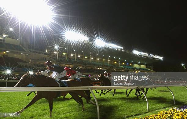 Michael Rodd riding Angelic Light wins the Printhouse Crokett Stakes during the Manikato Stakes Night at Moonee Valley Racecourse on October 26 2012...
