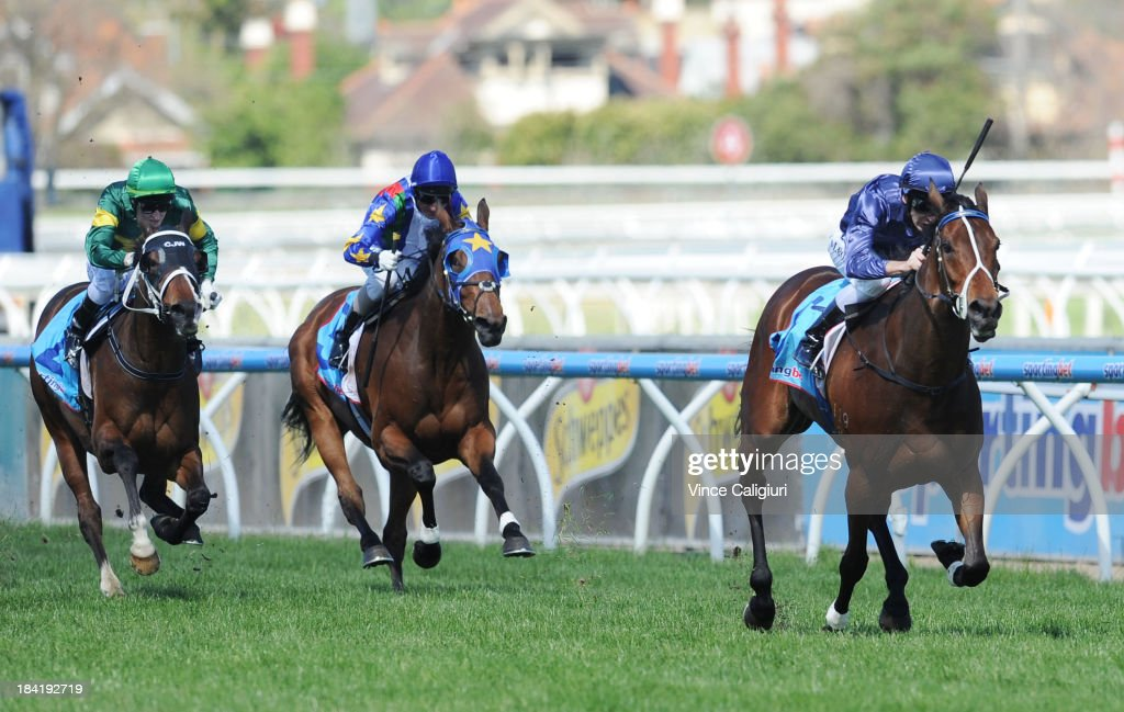 <a gi-track='captionPersonalityLinkClicked' href=/galleries/search?phrase=Michael+Rodd&family=editorial&specificpeople=850617 ng-click='$event.stopPropagation()'>Michael Rodd</a> riding Atlantic Jewel defeats Craig Newitt riding Foreteller and <a gi-track='captionPersonalityLinkClicked' href=/galleries/search?phrase=Glen+Boss&family=editorial&specificpeople=194758 ng-click='$event.stopPropagation()'>Glen Boss</a> riding Super Cool in the Cathay Pacific Caulfield Stakes during Melbourne Racing at Caulfield Racecourse on October 12, 2013 in Melbourne, Australia.