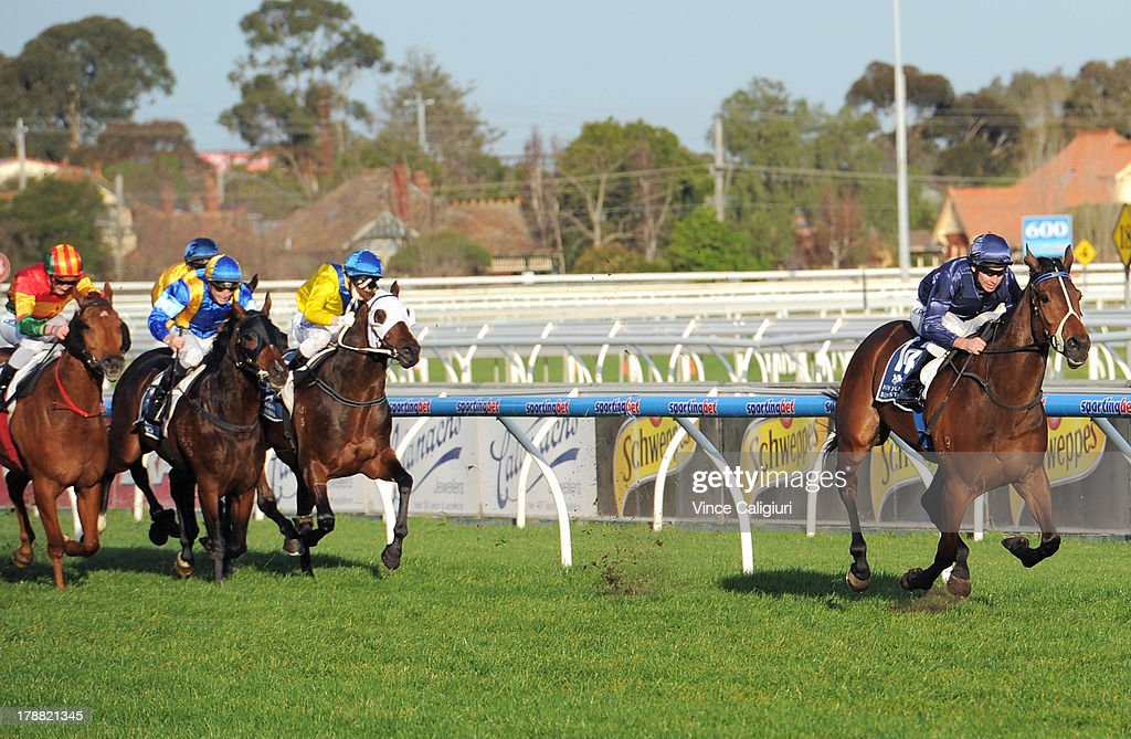<a gi-track='captionPersonalityLinkClicked' href=/galleries/search?phrase=Michael+Rodd&family=editorial&specificpeople=850617 ng-click='$event.stopPropagation()'>Michael Rodd</a> riding Atlantic Jewel wins the New Zealand Bloodstock Memsie Stakes during Melbourne racing at Caulfield Racecourse on August 31, 2013 in Melbourne, Australia.