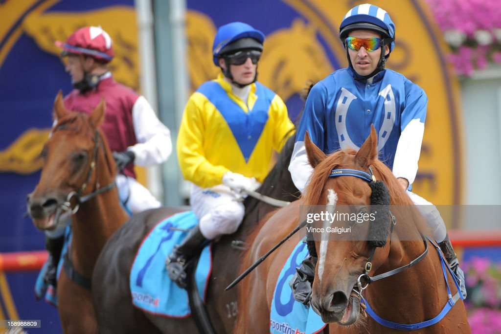 <a gi-track='captionPersonalityLinkClicked' href=/galleries/search?phrase=Michael+Rodd&family=editorial&specificpeople=850617 ng-click='$event.stopPropagation()'>Michael Rodd</a> riding Khalifa after wnning the Swettenham Stud Summer Championship Heat 5 during Caulfield racing at Caulfield Racecourse on January 5, 2013 in Melbourne, Australia.