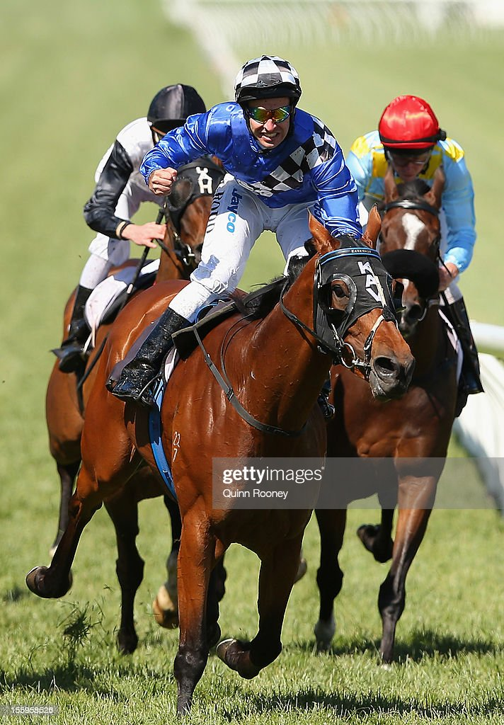 <a gi-track='captionPersonalityLinkClicked' href=/galleries/search?phrase=Michael+Rodd&family=editorial&specificpeople=850617 ng-click='$event.stopPropagation()'>Michael Rodd</a> riding Midnight Martini celebrates winning the Matriarch Stakes during 2012 Emirates Stakes Day at Flemington Racecourse on November 10, 2012 in Melbourne, Australia.